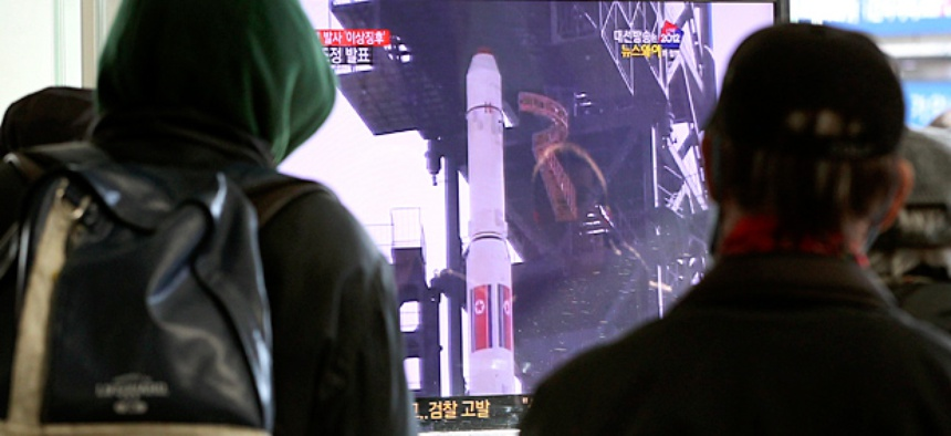 South Koreans watch a TV news program about North Korea's rocket launch plans at Seoul Railway Station in Seoul, South Korea.