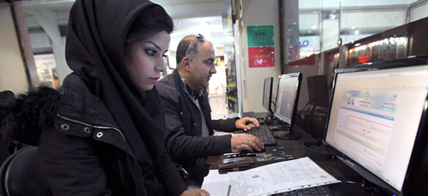 Iranians surf the web in an internet cafe at a shopping center, in central Tehran, Iran.
