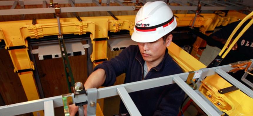 Verizon technician Kevin Pak installs Verizon Fios fiber optic cables during the ongoing hurricane restoration project in Manhattan.
