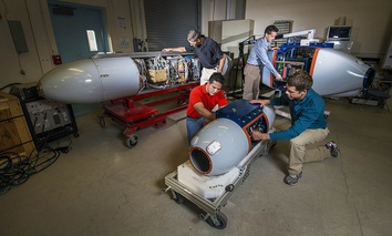 Researchers prepare pods that, airborne, will track radiation to its source and identify nuclear bombs.