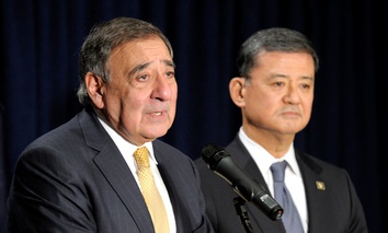 Veterans Affairs Secretary Eric Shinseki listens at right as outgoing Defense Secretary Leon Panetta speaks at the Veterans Affairs Department in Washington, Tuesday, Feb. 5, 2013.