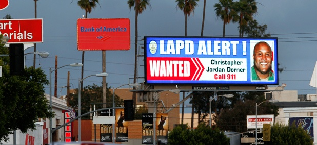 "A digital billboard shows a ""wanted"" alert for former Los Angeles police officer Christopher Dorner."