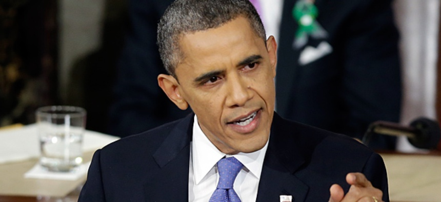 President Barack Obama gestures while giving his State of the Union address.
