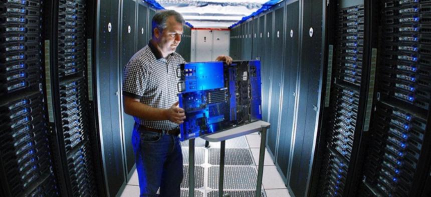 A Sandia reseracher inspects a Thunderbird supercomputer component.