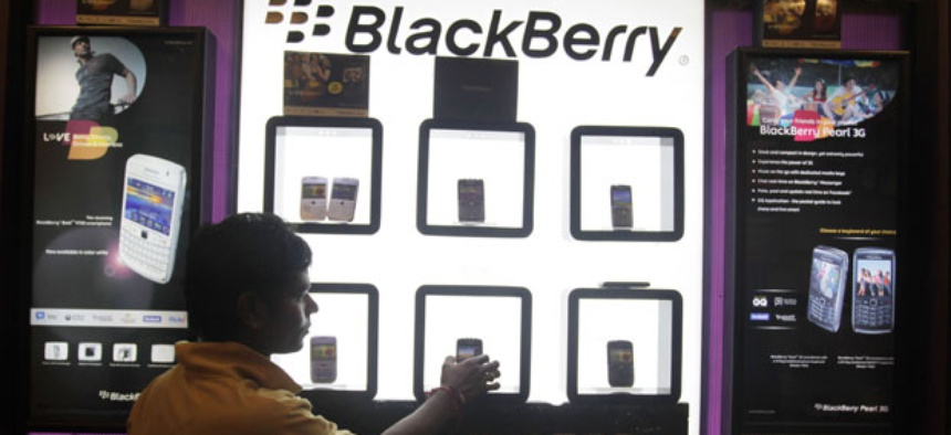 A shopkeeper displays BlackBerry mobile phones in his shop in Ahmadabad, India in 2010.