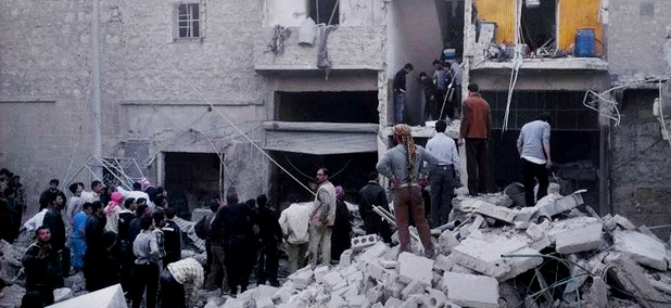 In this Monday, March 18, 2013, citizen journalism image Syrian citizens stand on rubble of houses that were destroyed due to Syrian forces airstrikes.