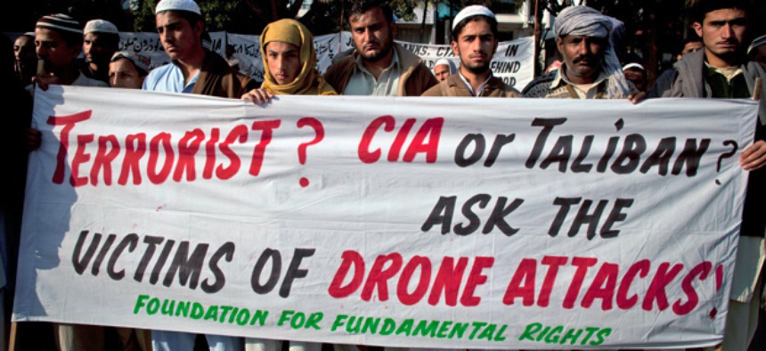 Pakistani tribal villagers hold a rally to condemn U. S. drone attacks.
