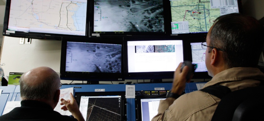 Activities of a Predator B unmanned aircraft are monitored at the Naval Air Station.