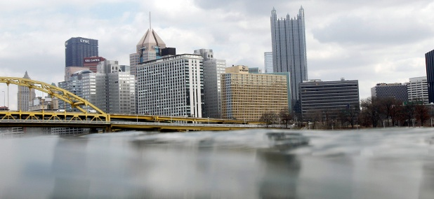 The Pittsburgh skyline rises above the waters of the Ohio River.