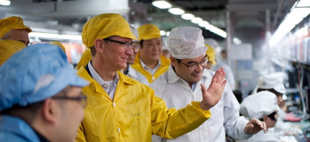 Apple CEO Tim Cook, center, visits the iPhone production line at the newly-built manufacturing facility Foxconn Zhengzhou Technology Park in China.