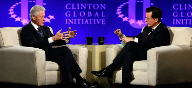 Former President Bill Clinton, left, and Comedy Central's Stephen Colbert during the Clinton Global Initiative at Washington University in St. Louis