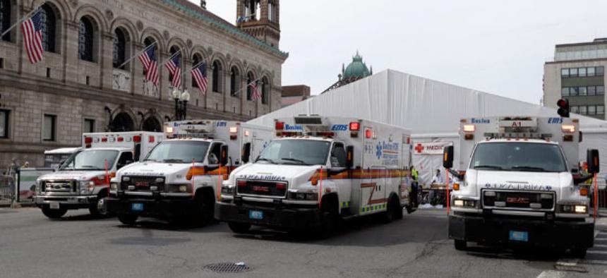 Ambulances wait near the medical tent at the Boston Marathon Monday.