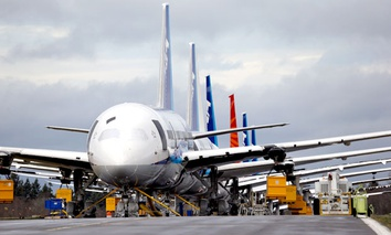 A line of Boeing 787 jets parked nose-to-tail at Paine Field in Everett, Washington.