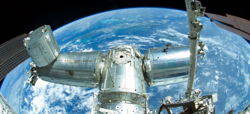 The International Space Station is seen orbiting the Earth.