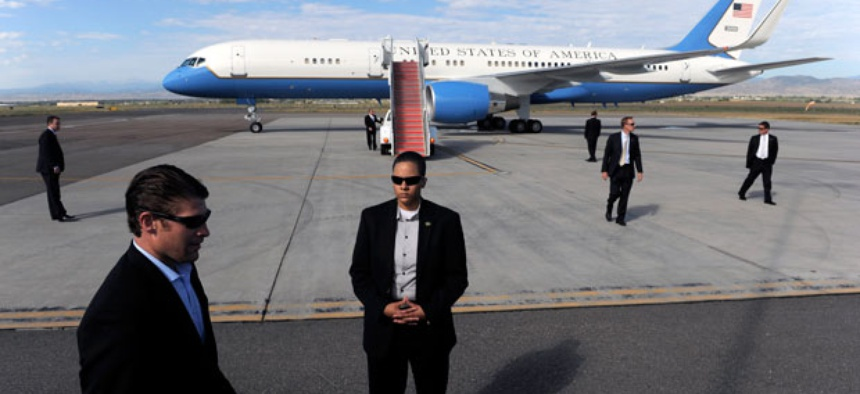 Secret Service agents Members of the Secret Service surround Air Force One as President Barack Obama prepares to depart the plane in September.
