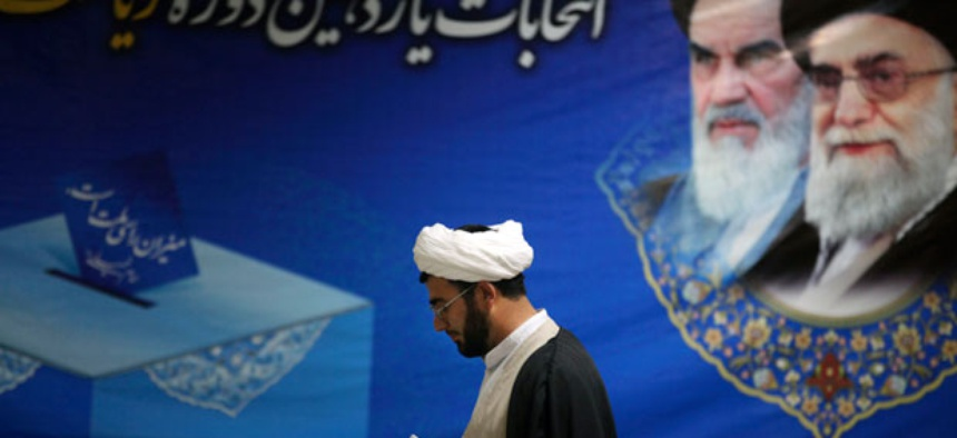 An Iranian cleric arrives at the election headquarters of interior ministry to register his candidacy for the upcoming presidential election.