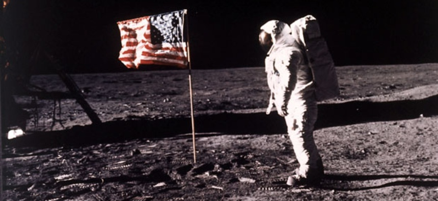 "Astronaut Edwin E. ""Buzz"" Aldrin Jr. poses for a photograph beside the U.S. flag deployed on the moon during the Apollo 11 mission."