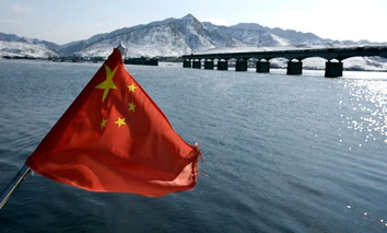 A Chinese flag is hoisted near the Hekou Bridge.