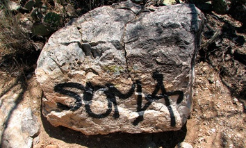 Significant graffiti damage is seen along the Douglas Springs Trail in Saguaro National Park near Tucson, Arizona.