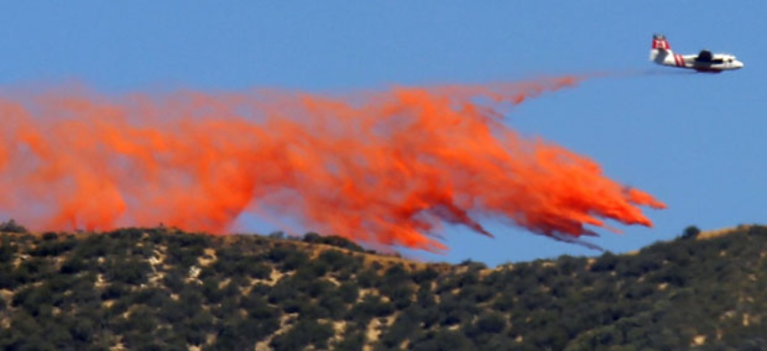 A tanker makes a slurry drop onto a 1,400-acre wildfire northeast of Castaic, Calif.,  in May.