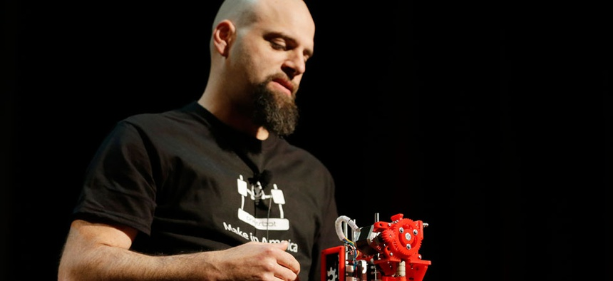 Brook Drum, the founder and CEO of Printrbot, displays and talks about his $299 portable 3D printer during the Hardware Innovation Workshop in San Mateo, Calif.
