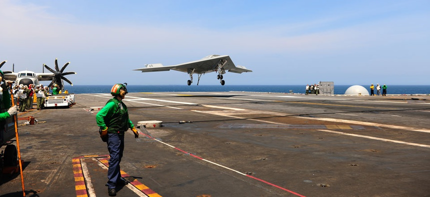 The X-47B lands aboard the USS George H.W. Bush aircraft carrier off the coast of Virginia.