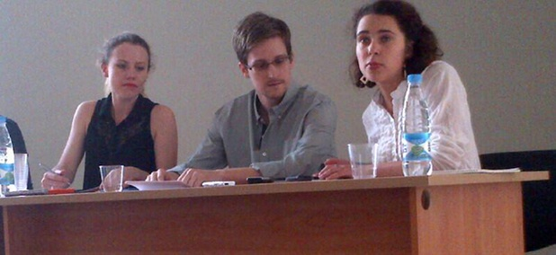 Edward Snowden, flanked by Sarah Harrison of WikiLeaks (right) and an unidentified woman.
