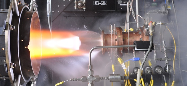 Rocket injector assembly built using additive manufacturing technology is hot-fire tested at NASA's Glenn Research Center.