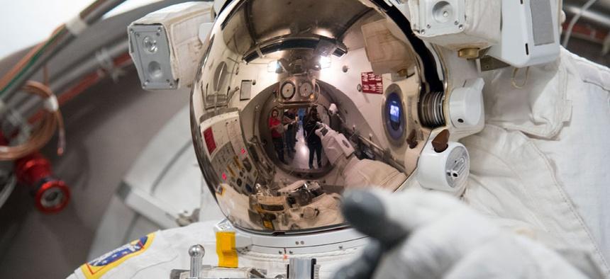 European Space Agency astronaut Luca Parmitano tests his spacesuit NASA's Johnson Space Center.