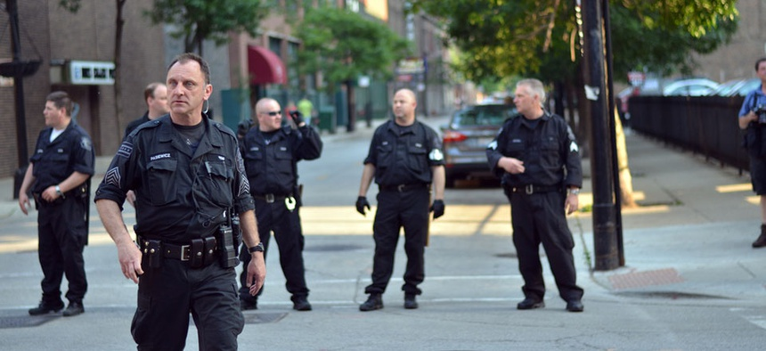 Chicago Police monitor protesters outside of a NATO summit.
