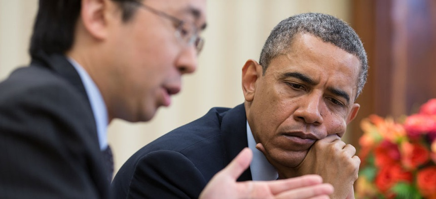 Todd Park and Barack Obama look at information on a tablet computer in April.
