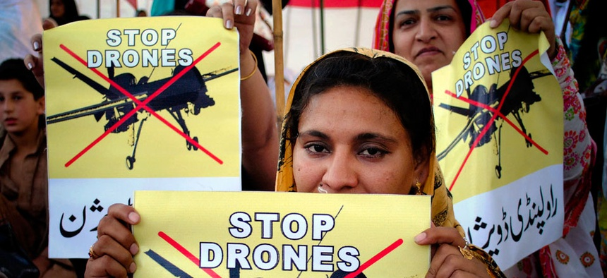 Pakistan women take part in a rally against the U.S. drone strikes in Pakistani tribal areas in Peshawar, Pakistan.