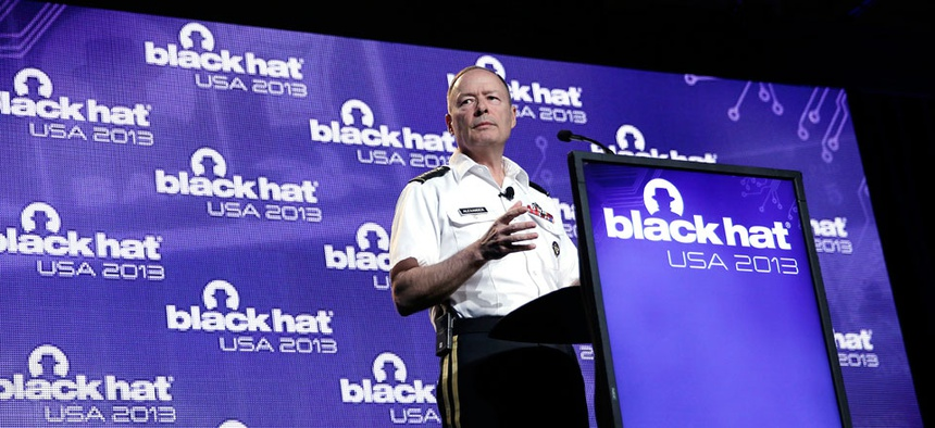 Army General Keith Alexander, head of the National Security Agency delivers a keynote address at the Black Hat hacker conference.