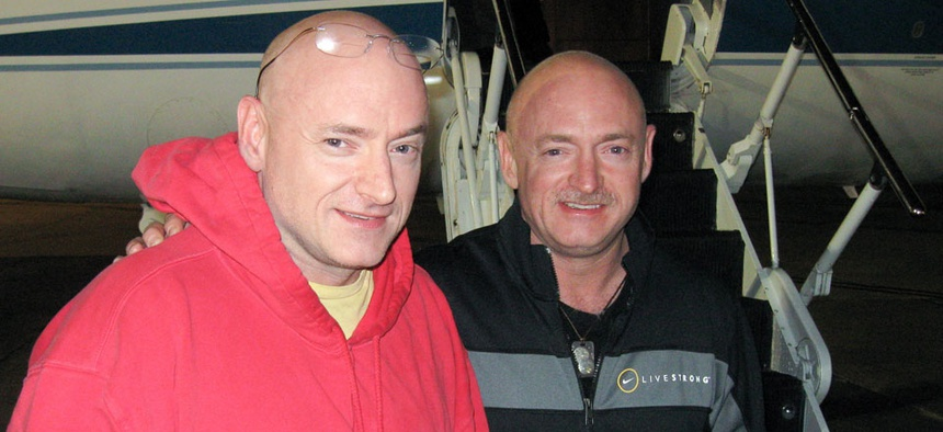 Expedition 26 Commander Scott Kelly, left, is reunited with his twin brother, Mark Kelly after 157 days on the International Space Station in March 2010.