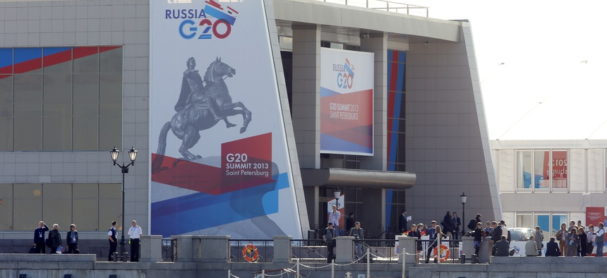 Journalists stand outside the media center of the G20 summit in St. Petersburg Wednesday.