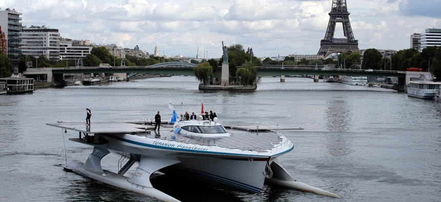 The Turanor PlanetSolar, the world's largest solar boat, travels on the Seine river in Paris, France.