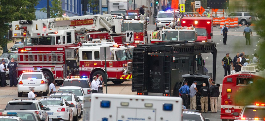 Emergency Response Team vehicles arrive to the scene at the Washington Navy Yard.