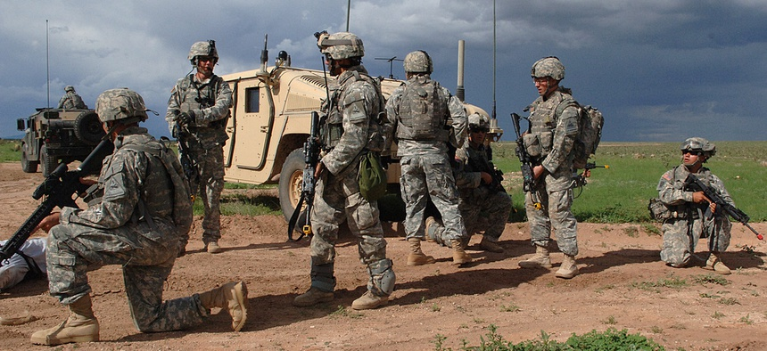 Soldiers move during an exercise at Fort Bliss in 2008.