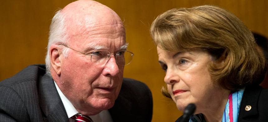 Senate Judiciary Committee Chairman Sen. Patrick Leahy, D-Vt., left, talks with Sen. Dianne Feinstein, D-Calif.