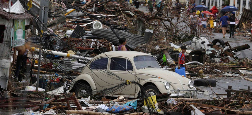 People search through debris in the Leyte province Tuesday.