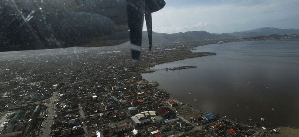 The view from a US C-130 transport plane from the United States Marines shows the  destruction of typhoon Haiyan.