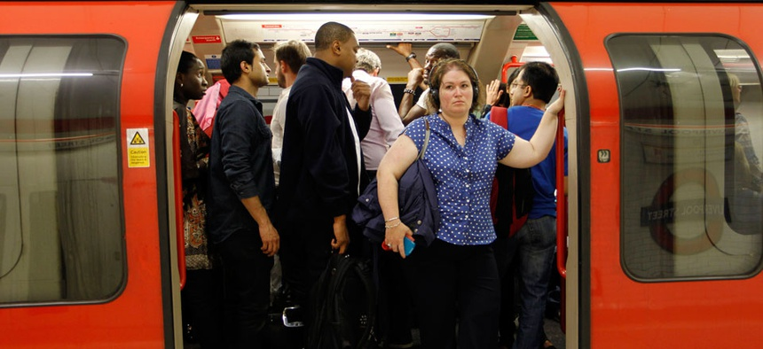 People in a Central Line underground train wait for the departure at Liverpool Street underground station in London.
