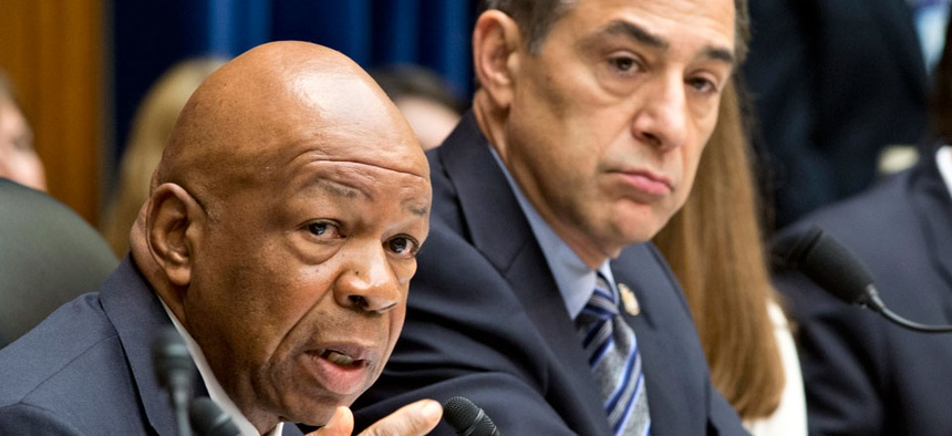 Rep. Elijah Cummings, D-Md., the ranking member of the House Oversight and Government Reform Committee, left, accompanied by the committee's Chairman Rep. Darrell Issa, R-Calif.