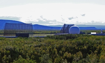 Early warning radar dot the landscape at Clear Air Force Station in Alaska.