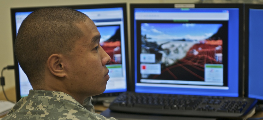 Sgt. Nirundorn Chiv works in the virtual lab at Fort Gordon in 2010.