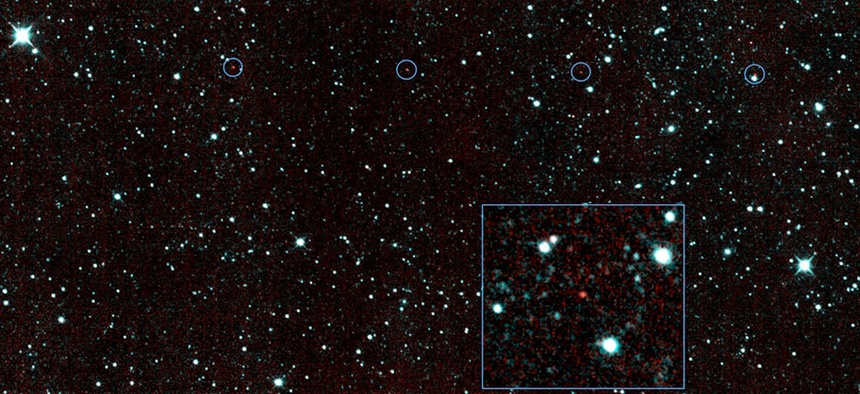 The six red dots in this composite picture indicate the location of the first new near-Earth asteroid seen by NASA's Near-Earth Object Wide-field Infrared Survey Explorer.