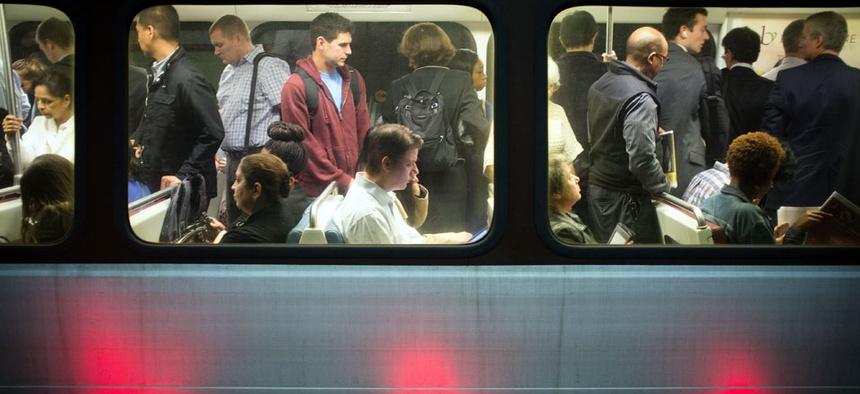 Passengers fill up Washington Metro subway cars in Arlington, Va.