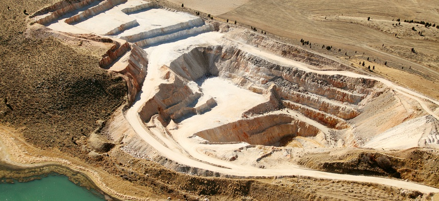 An aerial view of an open pit phosphate mine.
