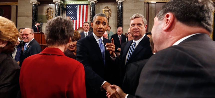 President Barack Obama shakes hands as he leaves after giving the State of Union address.