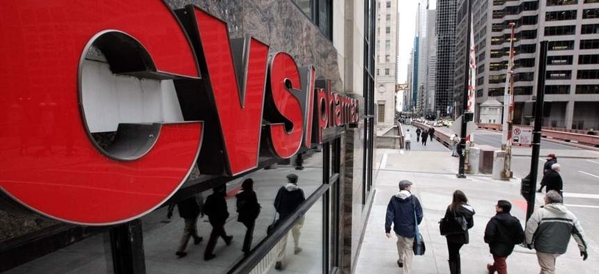 Pedestrians walk pass a CVS store in Chicago.